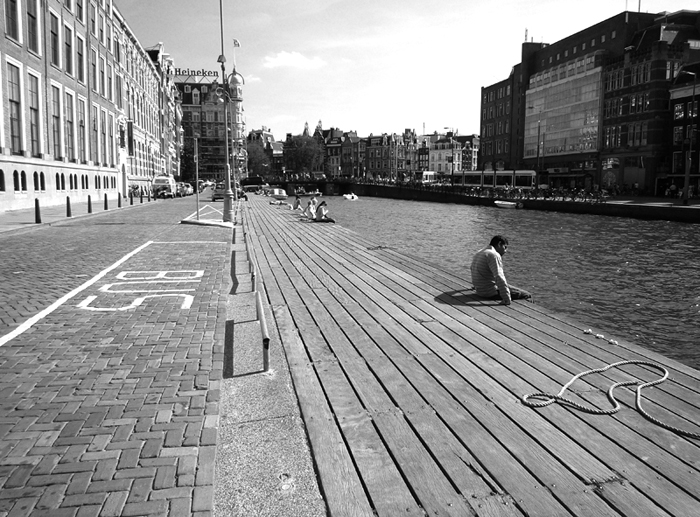 Man next to canal crop B&W